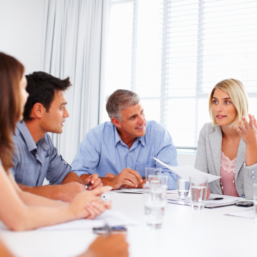 Female executive making a point in meeting